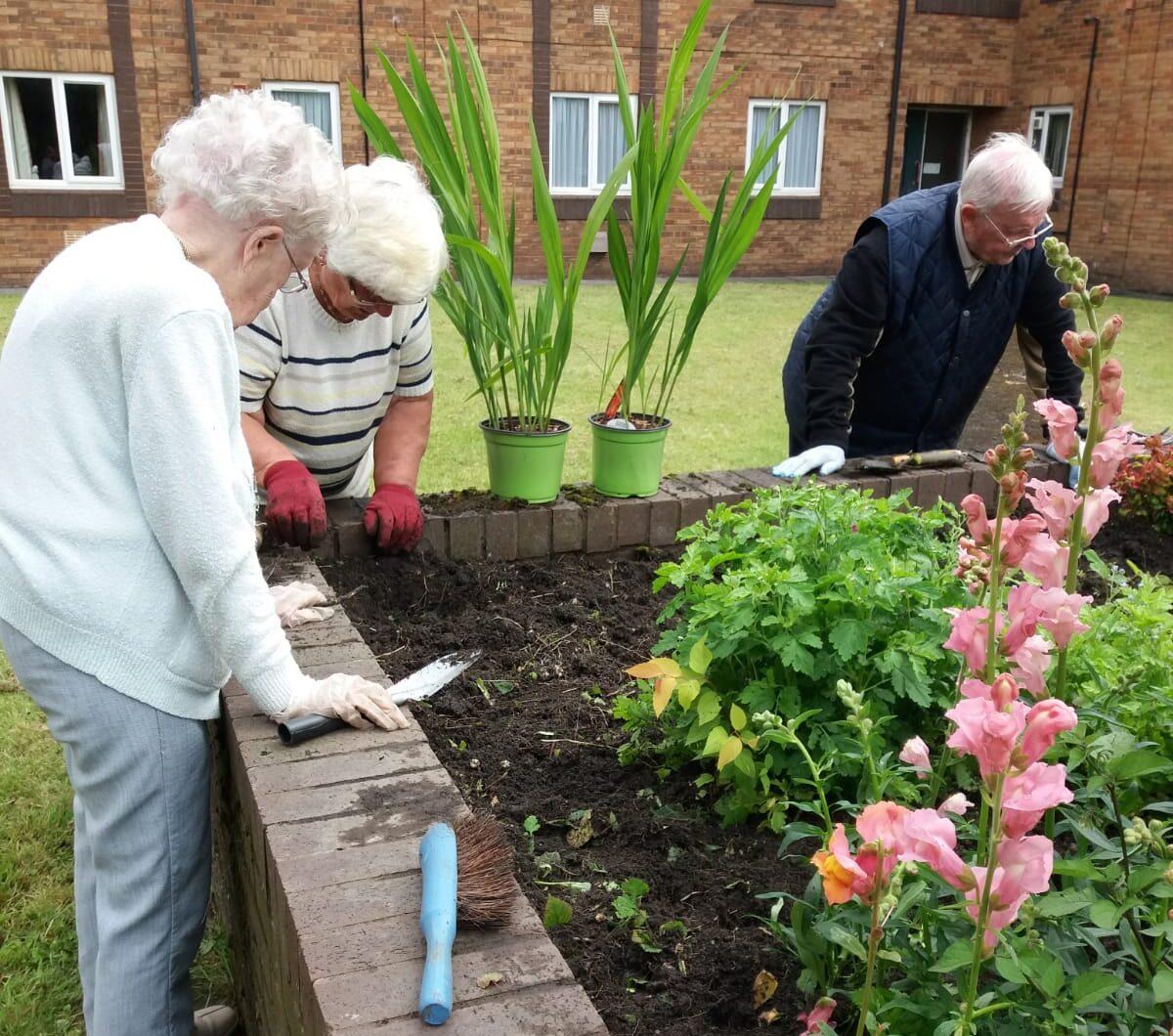 Residents tending to the community garden